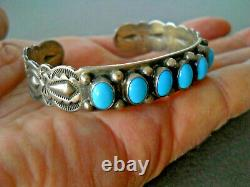 JEFF LARGO Native American Turquoise Row Sterling Silver Repousse Stamped Cuff