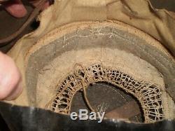 Original U. S. WW1 M1917 helmet, stamped ZD199 with Orig. USMC badge